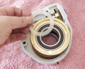 Here is the base of the worm carrier. You can see another thin teflon washer here. This may be stuck to the mounts bearing or the worm carrier so take care. Set this washer aside and make sure it is not confused with the washer from the base of the declination shaft removed earlier.